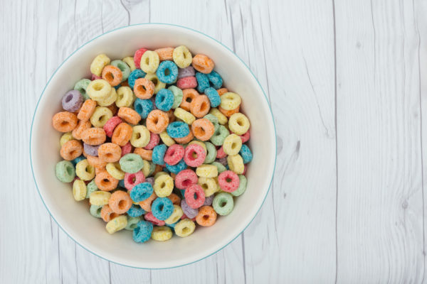 Bowl of Cereal, Colorful cereal in a bowl on weathered wood