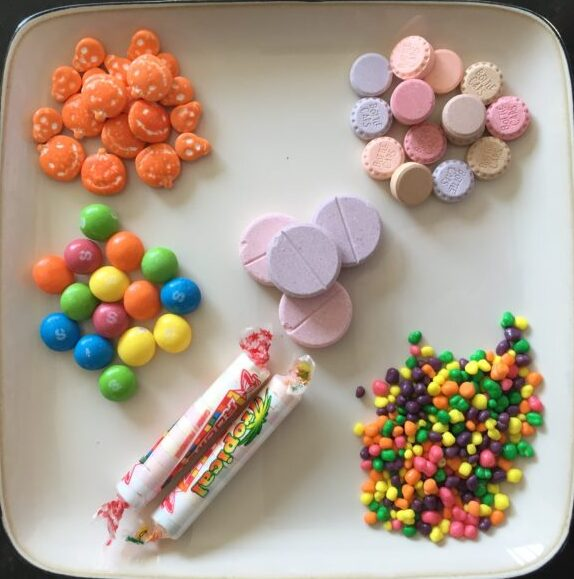 Each of these piles of candy contain ~15g of fast-acting sugar - the equivalent of one low treatment for most children and teens.